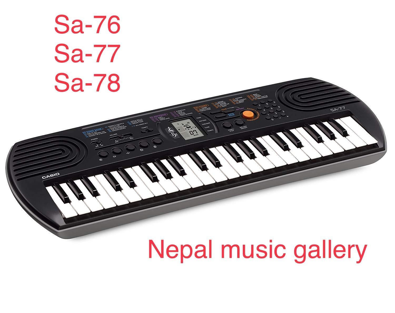 Casio SA-77 EMI-Keyboard Mini With Free Adapter - Black/White